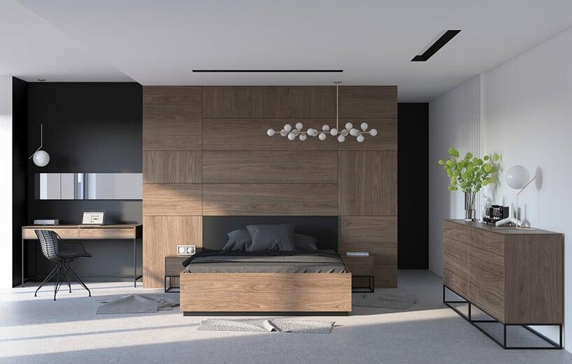 stylowe wnętrze zciemną ścianą oraz ciemno brązowymi meblami iczarnym łóżkiem