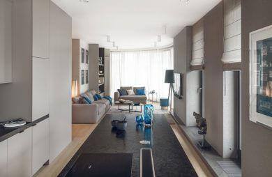 wnętrze apartamentu z połączoną kuchnią i salonem