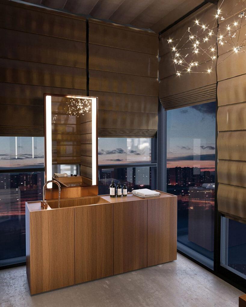 łazienka zdrewnianą umywalką idużymi oknami