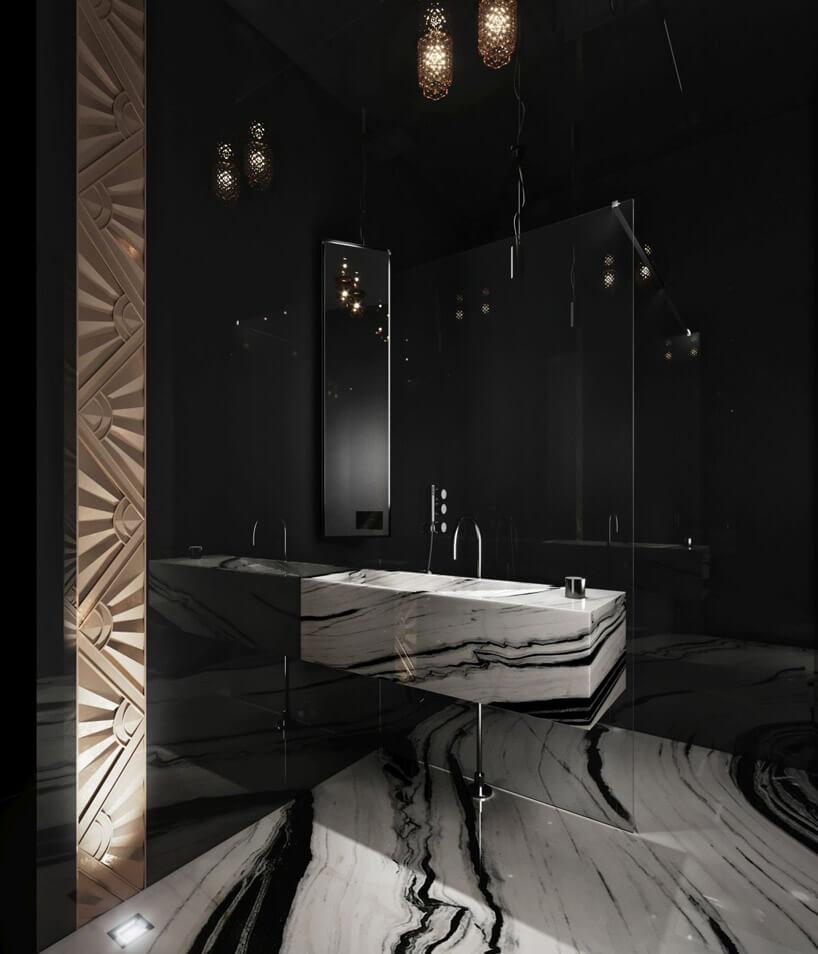 łazienka zczarnymi kafelkami ibiałą zdobioną umywalką