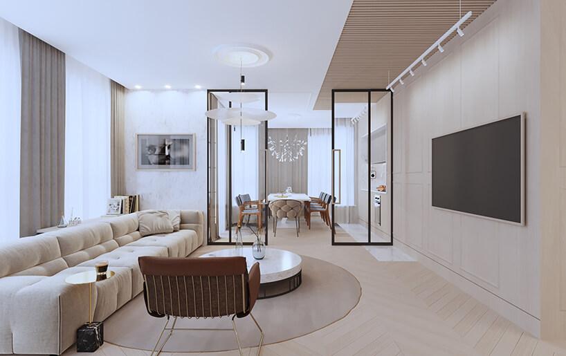 nowoczesny apartament od Sikora Wnętrza jasne beżowe wnętrze salonu zdużą sofą iprzeszkloną ścianą