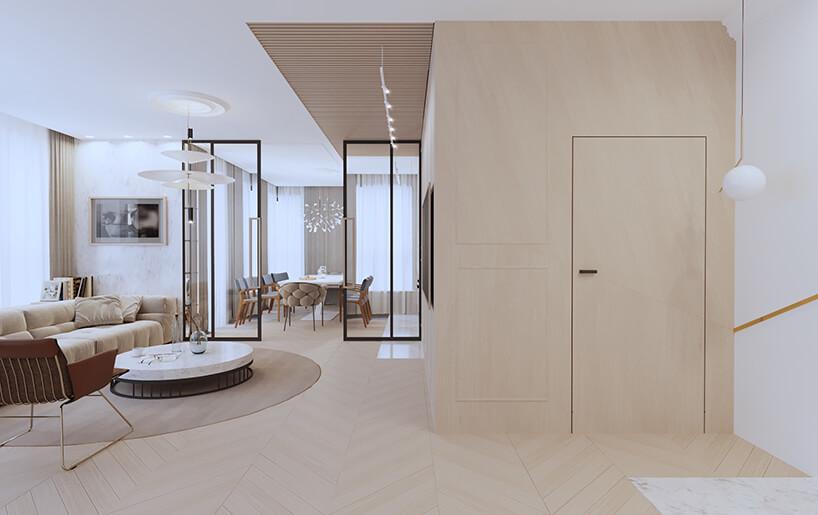 nowoczesny apartament od Sikora Wnętrza biały ibezowy przedpokój połączony zsalonem