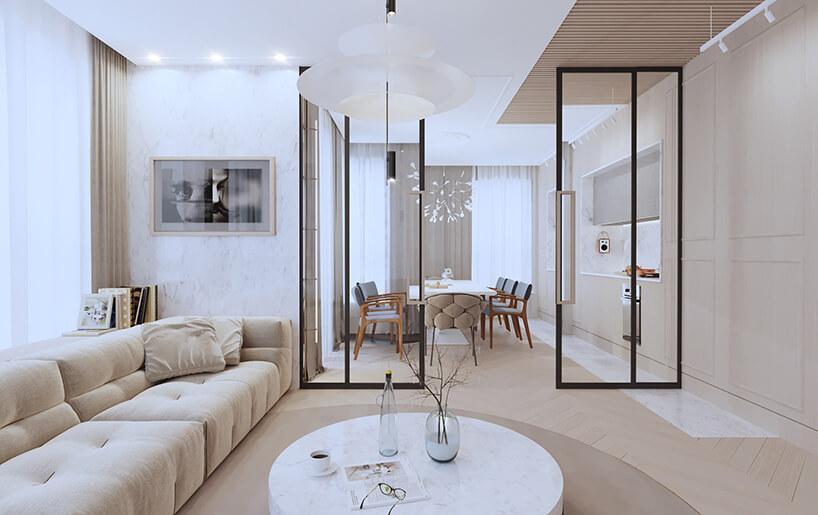 nowoczesny apartament od Sikora Wnętrza niski kamienny stolik wbeżowo białym salonie