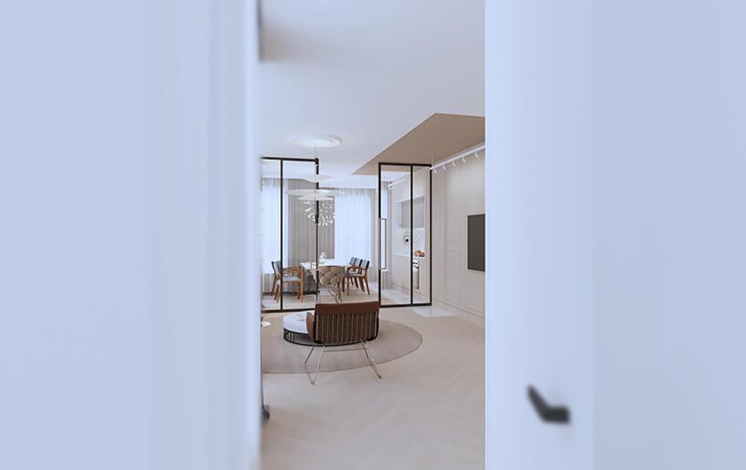 nowoczesny apartament od Sikora Wnętrza widok na salon przez lekko uchylone białe drzwi
