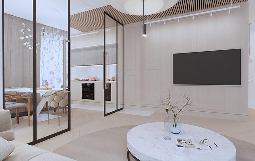 nowoczesny apartament od Sikora Wnętrza salon zbeżową ścianą za dużym telewizorem
