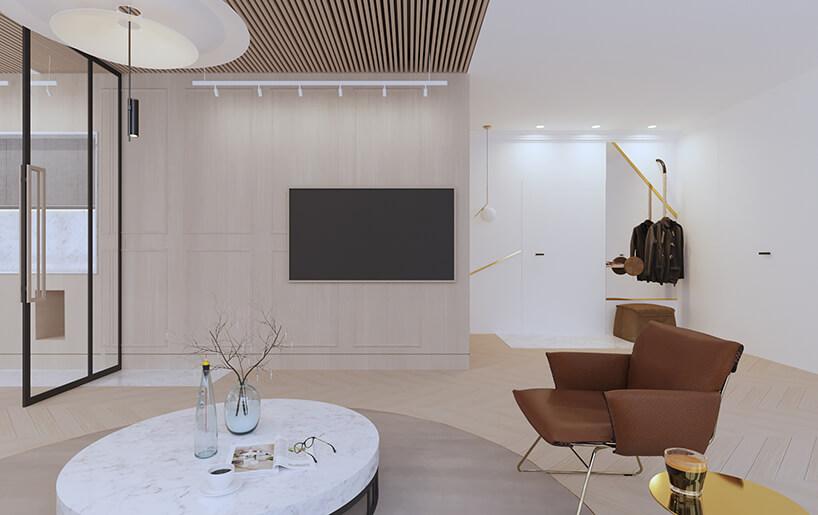 nowoczesny apartament od Sikora Wnętrza brązowy fotel przy niskim kamiennym stoliku
