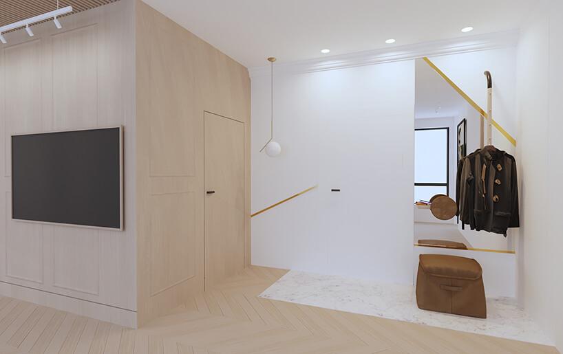 nowoczesny apartament od Sikora Wnętrza przedpokój zbiałą ibeżową ścianą zwkomponowanymi drzwiami