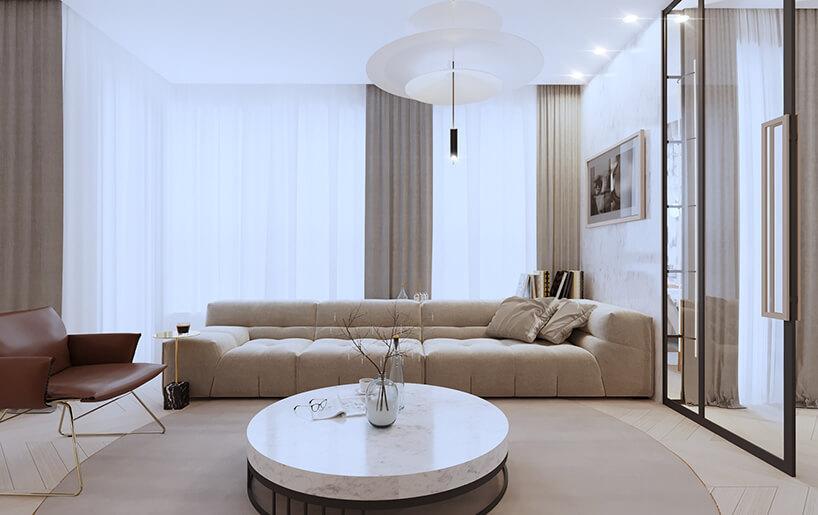 nowoczesny apartament od Sikora Wnętrza niski stolik zkamiennym blatem przed długa beżową sofą