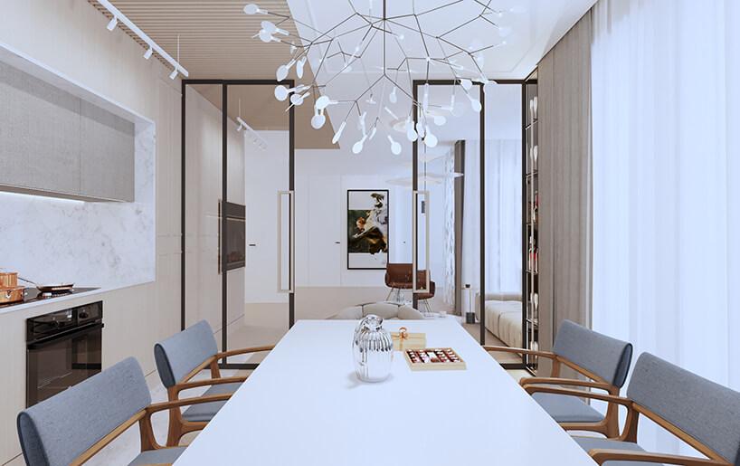 nowoczesny apartament od Sikora Wnętrza widok zjadalni przez przeszkloną ścianą na salon
