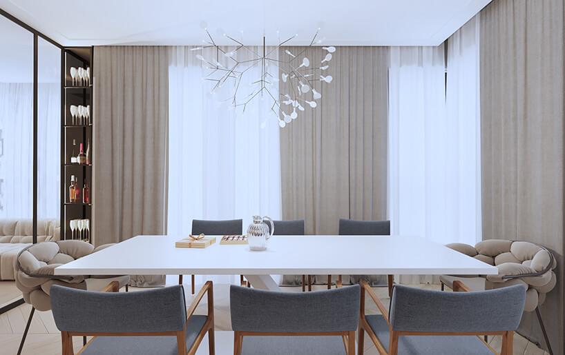 wyjątkowy czarny żyrandol zbiałym zwieńczeniami na białym stołem wjadalni