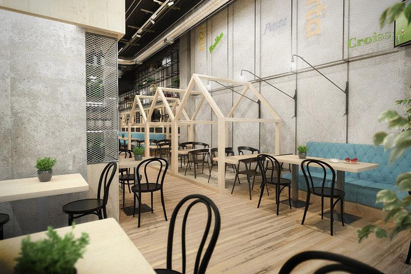 restauracja zdrewnianymi konstrukcjami wokół stolików