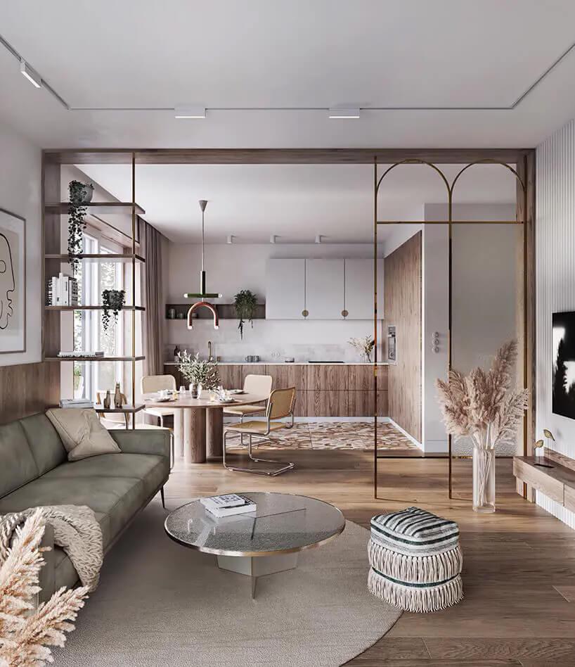 ciepłe wnętrze mieszkania zpołączonym salonem zkuchnią