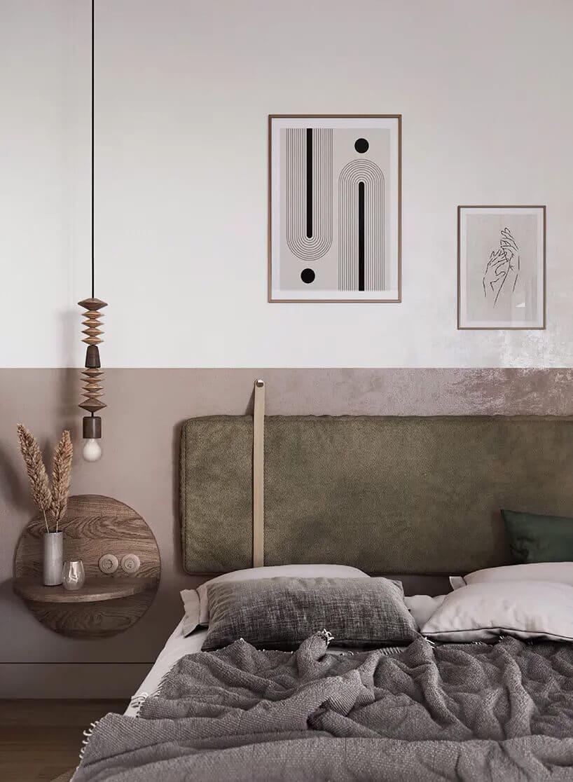 wisząca lampka przy pomalowanym fragmencie ściany zpodwieszoną szafką nocna obok łóżka