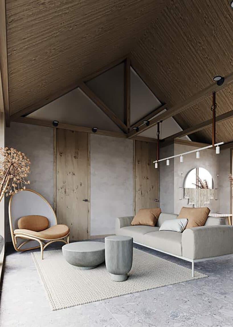 wysokie wnętrze domu zkopertowym dachem zdrewnianym pokryciem od wnętrza oraz betonem na ścianach