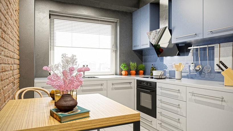 kuchnia zceglaną ścianą przy oknie zrzymskimi roletami