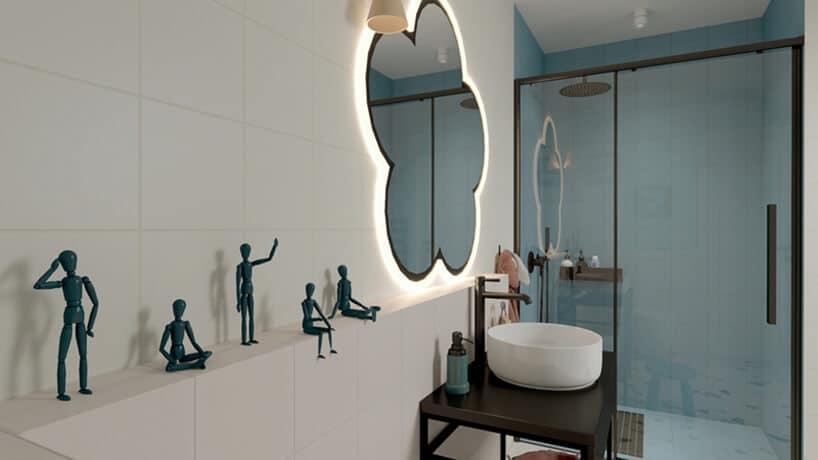 łazienka zpodświetlanym lustrem wkształcie kwiatka zpółką zfigurkami