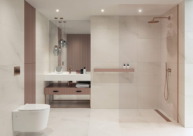 jasne wnętrze zdodatkami różowymi oraz szybą przy złotym prysznicu