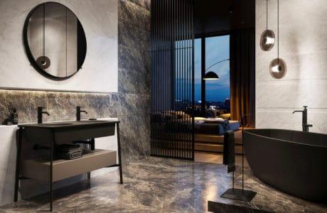 luksusowa łazienka wykończona ciemnymą armaturą oraz marmurem na tle sypialni