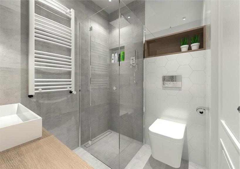 szare duże kafle obok bieli małej łazienki