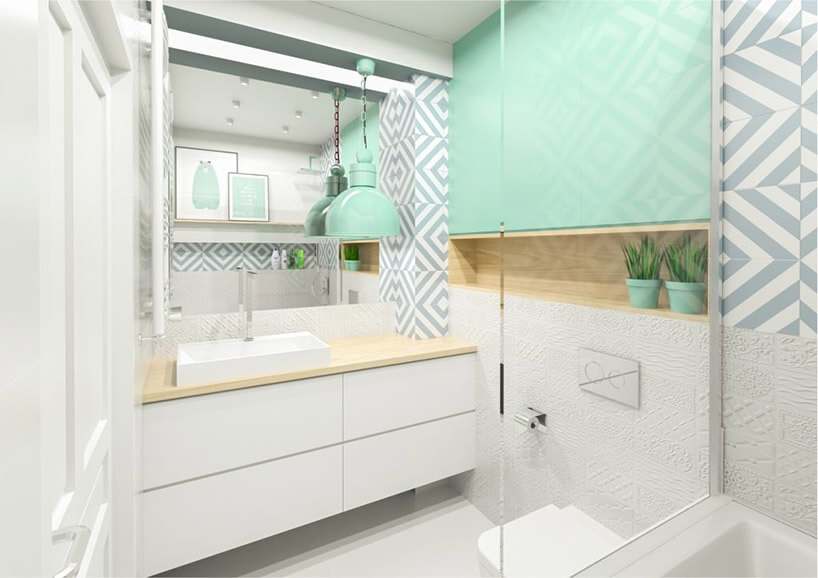 jasno zielony akcent wbiałej małej łazience