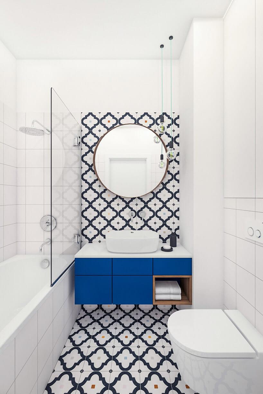 gustowna mała łazienka zniebieską szafką