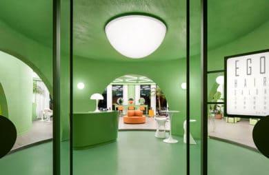 Barwa awokado z futurystycznym rysem: wnętrze salonu fryzjerskiego w Pekinie