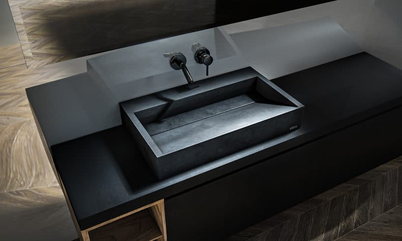 elegancka czarna betonowa umywalka na czarnym blacie