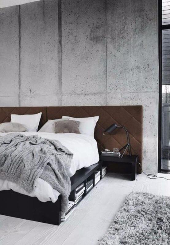 wykończona betonem sypialnia
