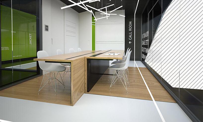 wnętrze pavillonu zdużym stołem znogą po środku ibiałym krzesłami