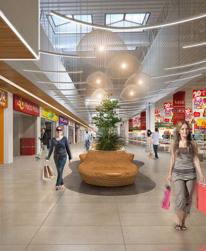 duże centrum handlowe zróżnymi sklepami