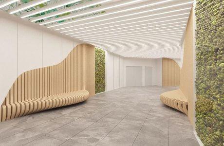 duży korytarz z betonową posadzką i drewnianymi ścianami