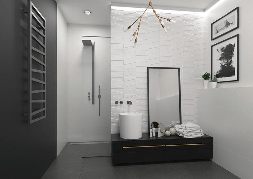 biało-czarna łazienka zbiałymi płytkami przestrzennymi