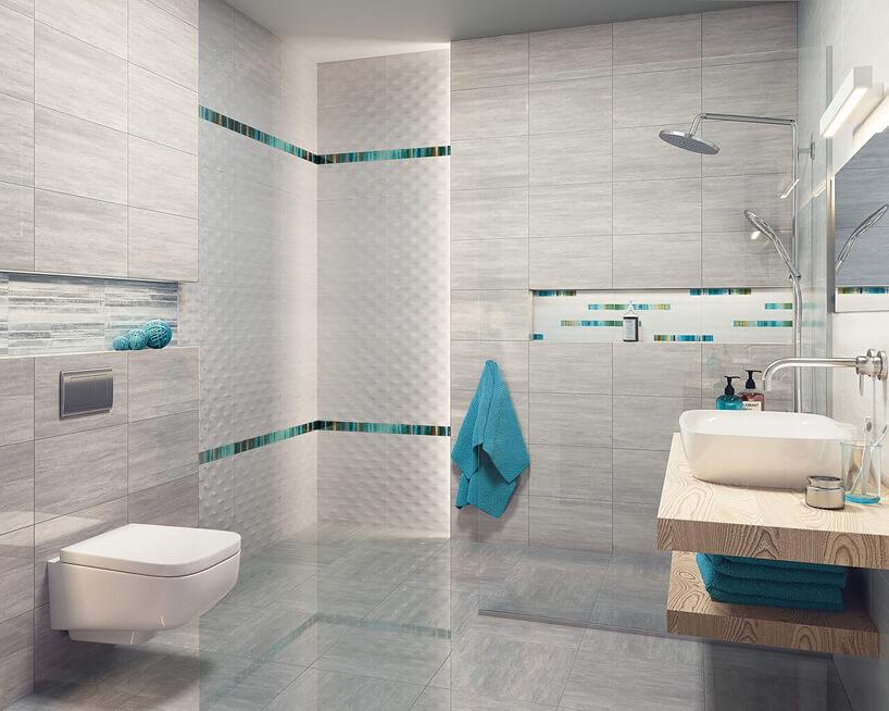 białe płytki przestrzenne Nati/ Nato od Ceramika Paradyż waranżacji łazienki wotoczeniu szarości zniebieskim akcentami