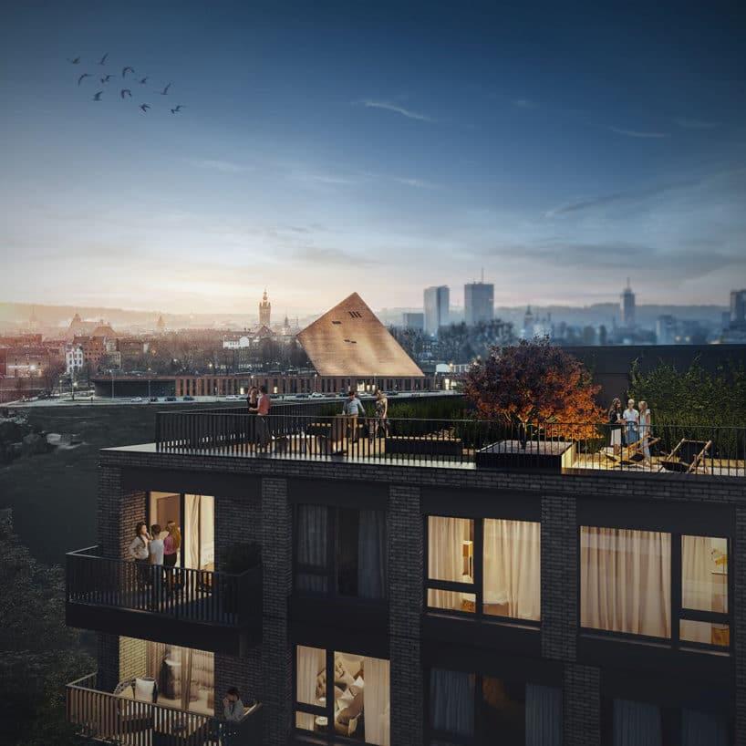 nowoczesny apartamentowiec Chlebova wGdańsku element dachu na tle miasta