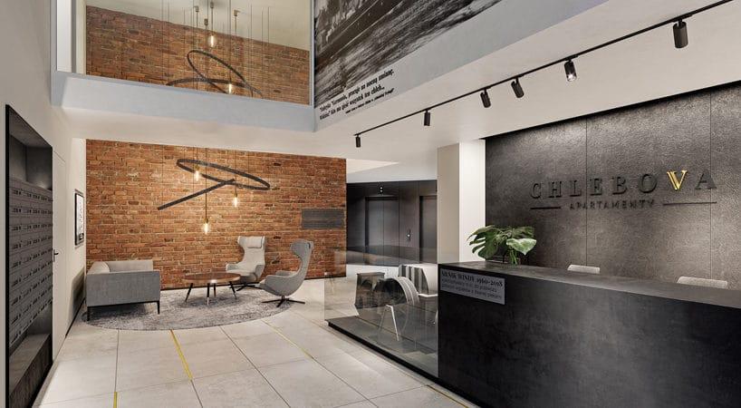 nowoczesny apartamentowiec Chlebova wGdańsku elegancka recepcja zczarnego kamienia na tle białych ścian zceglanymi elementami