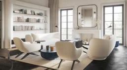 salon zciemno brązową podłogą zdesek oraz śnieżno białymi fotelami ikanapą