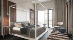 sypialnia zdrewnianymi dekorami na ścianach oraz łóżkiem zkwadratową konstrukcją wkolorze bieli