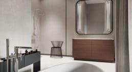 łazienka zszafką wlekkim jasnym brązie pod lustrem zczarną zaokrągloną konstrukcją