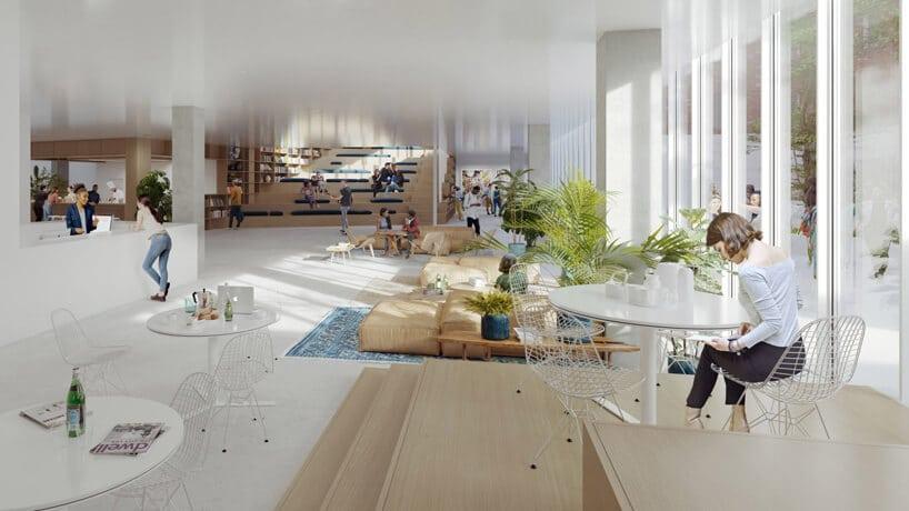 białe wnętrze przestrzeni co-livingowej różne enklawy zsiedziskami imałymi stolikami wopen space