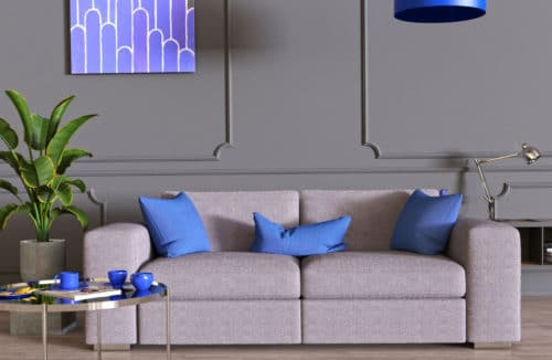 szara komoda przy ścianie z dekorami z filetowym obrazem obok niebieskiego klosza lampy