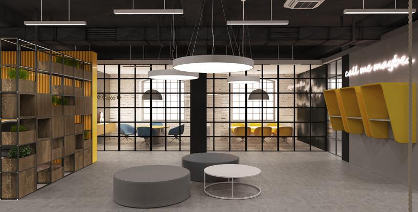 część socjalna przestrzeni biurowej zokrągłymi siedziskami iżółtymi budkami na ścianie od Consido