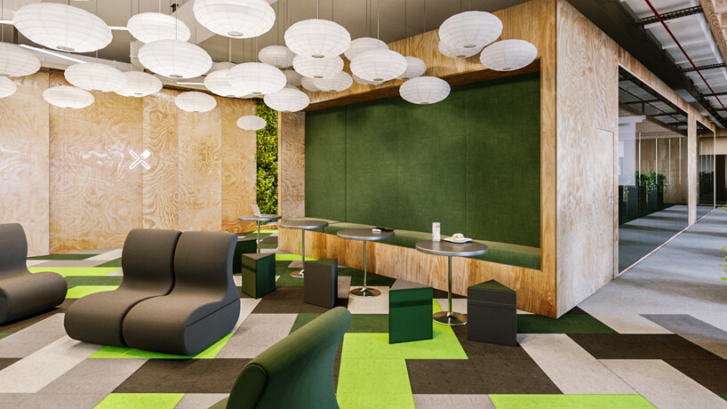 przestrzeń socjalna wbiurze wzielonym kolorze zelementami drewna od Consido