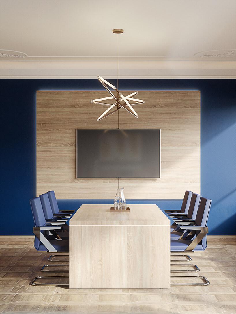 mała sala konferencyjna wniebieskim kolorze wykończona wdrewnie od Consido