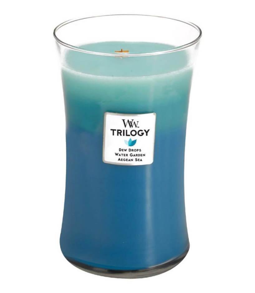 wysoka niebiesko-zielona świeca zapachowa