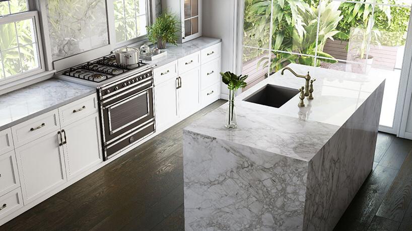biała kuchnia kuchnia wklasycznym stylu zwyspą zbiałego kamienia Dekton Bergen zkolekcji Stonika od Cosentino