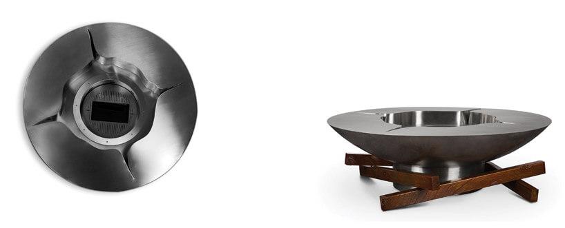 metalowy okrągły krążek postawiony na drewnianych kawałkach desek
