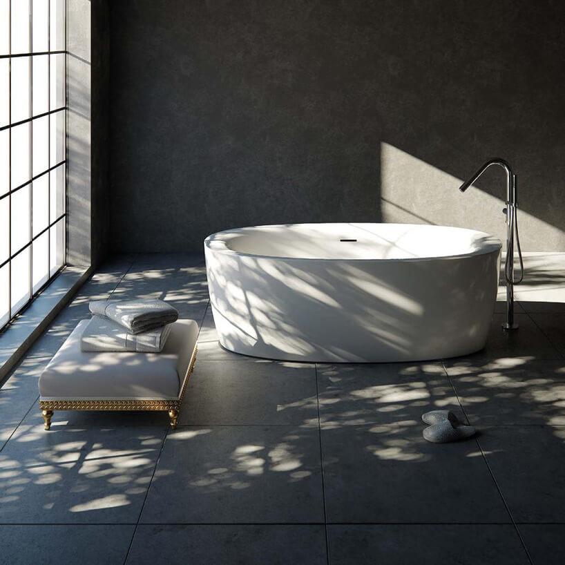 biała elegancka wolnostojąca wanna Bona zgrubymi brzegami wszarej łazience zdużym oknem