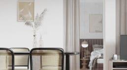 krzesła zjasnym materiałem zdziurkami awtle pionowe lustro
