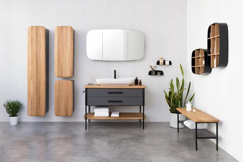 meble łazienkowe zkolekcji Oval od DEVO waranżacji łazienki zbiałymi ścianami iszara podłogą