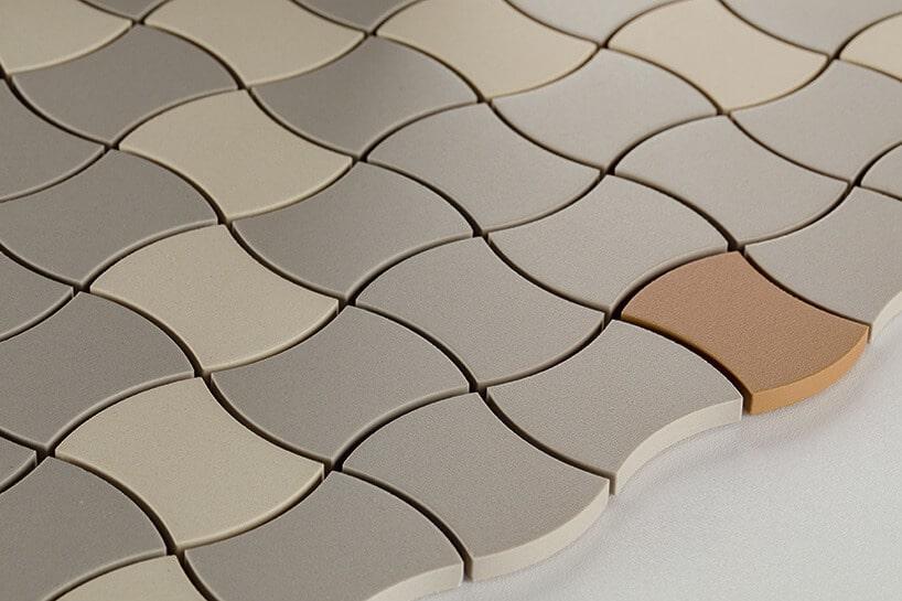 ceramiczne płytki oza okrąglonym kształcie wkolorze szarości ibeżu